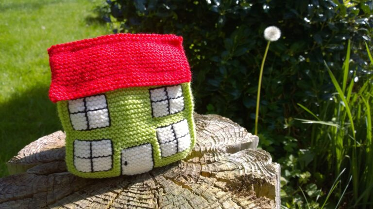 knitted house on a tree stump